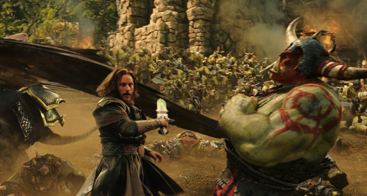 """Commander Anduin Lothar (TRAVIS FIMMEL) defends himself against an orc from The Horde in """"Warcraft.""""  From Legendary Pictures and Universal Pictures comes """"Warcraft,"""" an epic adventure of world-colliding conflict based on Blizzard Entertainment's global phenomenon."""